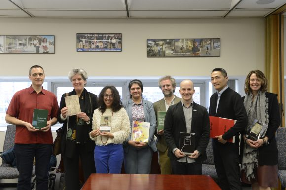 Photo featuring faculty and their publications.
